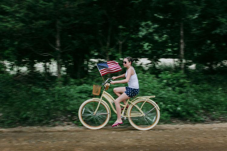 Man riding bicycle on street