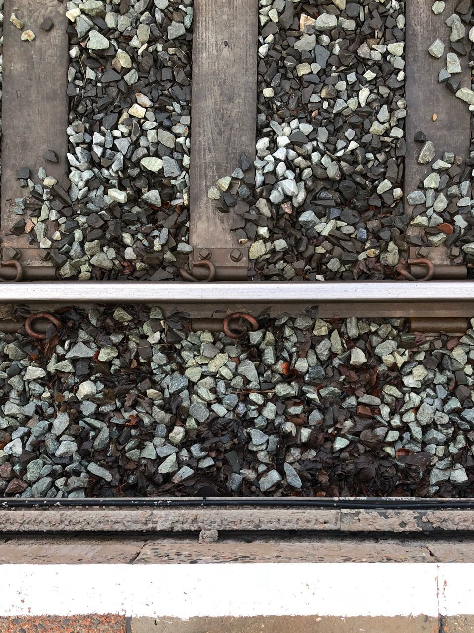 abundance, day, large group of objects, no people, railroad track, outdoors, pebble, railroad tie
