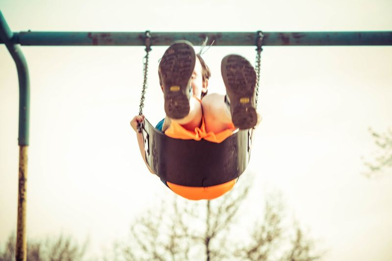 Man playing with swing in park