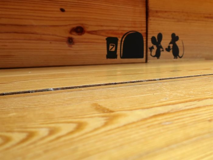 Guests in the Kitchen :-P Architecture Brown Built Structure Close-up Communication Day Flooring Guest Hardwood Floor Indoors  Mouse No People Number Pattern Selective Focus Table Text Textured  Wall - Building Feature Wood Wood - Material