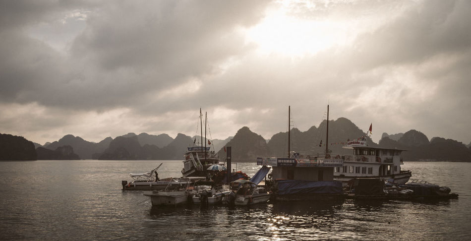 Sun rise over Ha Long Bay, Vietnam ASIA Beauty In Nature Boat Cloud - Sky Day Harbor Mode Of Transport Moored Mountain Mountain Range Nature Nautical Vessel No People Outdoors Sailing Scenics Sea Sky Tranquil Scene Tranquility Transportation Vietnam Water Waterfront Yacht