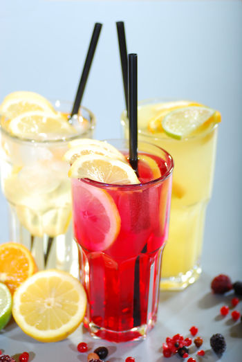 Beverage Close-up Drink Drinking Glass Drinking Straw Food And Drink Freshness Indoors  Large Group Of Objects Lemon Lemonade Non-alcoholic Beverage Orange Pink Color Red Refreshment Serving Size Table Yellow
