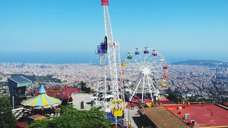 Amusement Park Built Structure Arts Culture And Entertainment Ferris Wheel Architecture Clear Sky Amusement Park Ride Outdoors Day Building Exterior No People Cityscape Sky City Barcelona