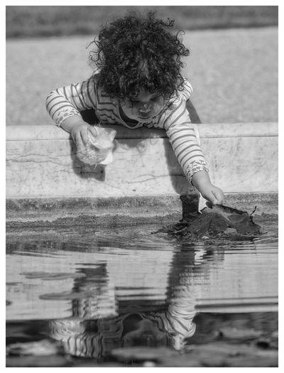 Full length of kid in water