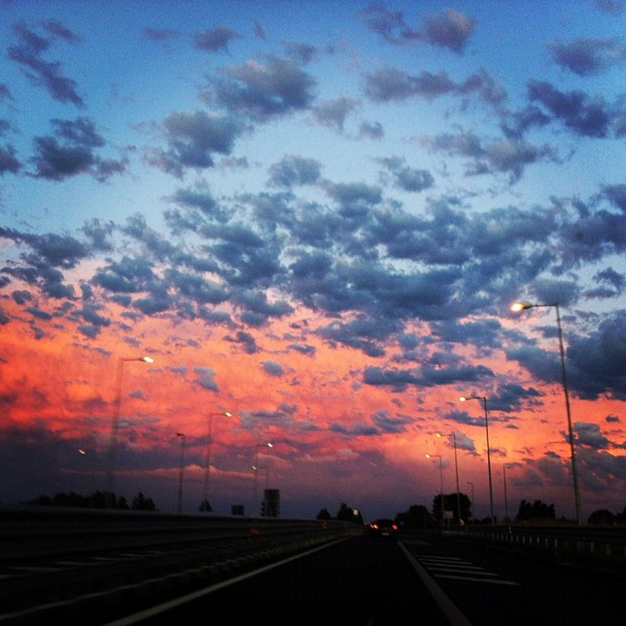 sunset, road, cloud - sky, dramatic sky, sky, transportation, street, no people, car, nature, the way forward, scenics, beauty in nature, outdoors, city