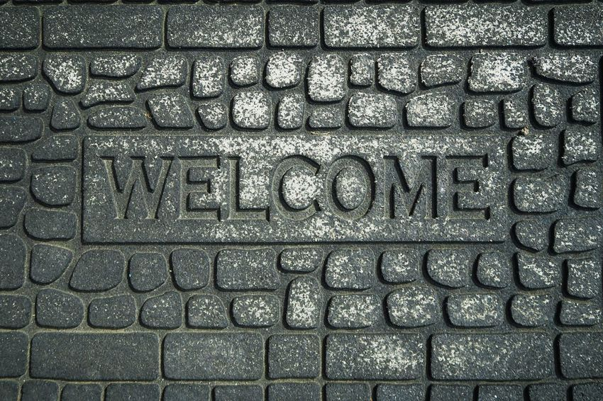 Welcome home. Welcome Word Engraved Stones Mat Design Pattern, Texture, Shape And Form Home Sweet Home Grey Surfaces Cracks Background Banner Wallpaper Meme Socialmedia Quotes