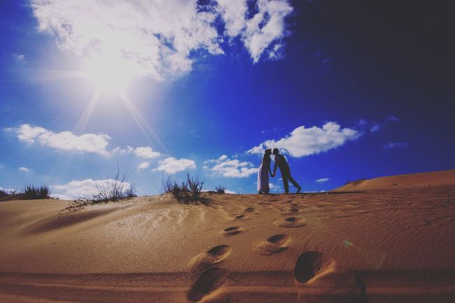 Couple Wedding Photography Bride Groom Silhouette Beach Sand Dune Oil Pump Desert Sand Sunlight Arid Climate Sky Cloud - Sky Landscape FootPrint Star Field Sandy Beach Shining Sunbeam Lens Flare Sun
