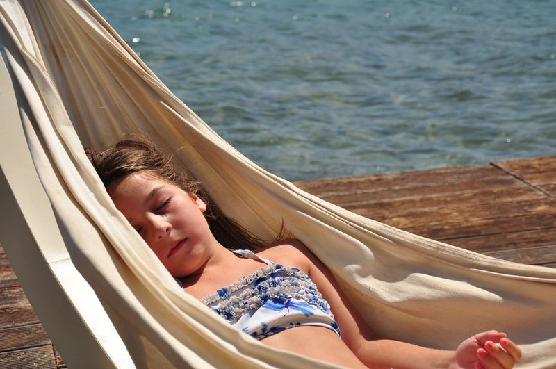 Girl sleeping in hammock