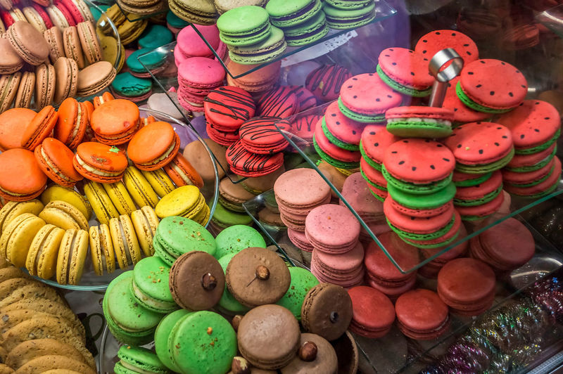 High angle view of colorful macaroons for sale in shop