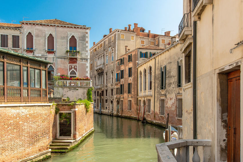A canal in Venice Architecture Building Canal Clear Sky Day Mode Of Transportation Nature No People Outdoors Reflection Residential District Sky Transportation Travel Destinations Water Waterfront Window