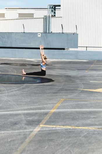 Full length of man jumping on floor
