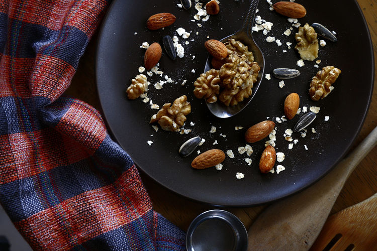 walnut, almond nuts, sunflower seeds and oats on a plate Food Food And Drink Taste Flavor Ingredient Raisin Nut - Food Textile High Angle View Directly Above Close-up Food And Drink Almond Sunflower Seed Dried Fruit Walnut Nutshell Oats - Food