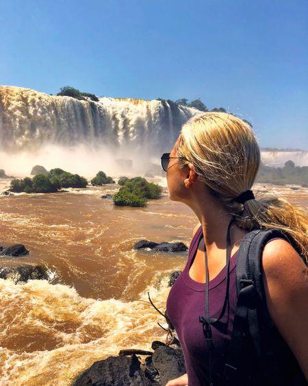 Woman looking at iguacu falls