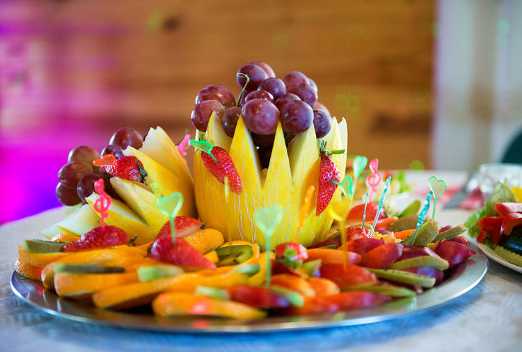 Close-Up Of Fruit Salad Served In Plate On Table