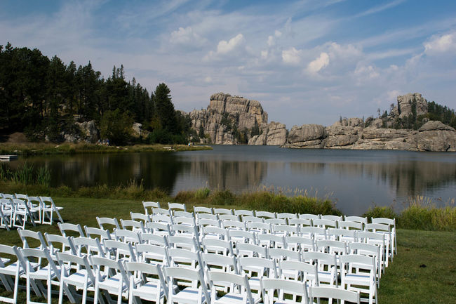 Chairs put out in front of a lake in Black Hills National Forest, South Dakota Landscape Landscape_photography Landscape_photography Black Hills Black Hills, SD. Chair Pond Rock Water Reflections Beauty In Nature Day Lake Mountain Nature No People Outdoors Sky Water