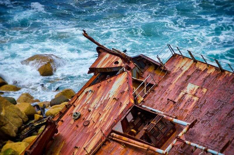 High angle view of rusted deck at sea shore