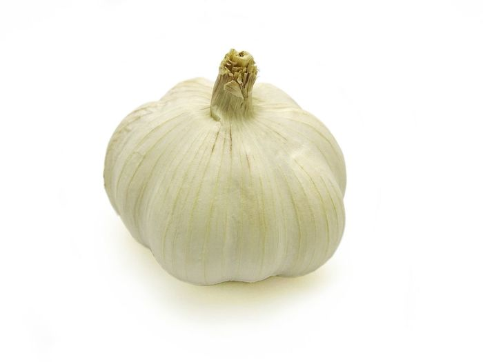 Garlic head isolated on white background. A type of cooking ingredient. Herbal plants and healthy food related to blood pressure, antibiotics, etc. Side view. Food And Drink Healthy Eating Freshness White Background Food Studio Shot Vegetable No People Vegetarian Food Close-up Indoors  Nature Day Single Object Seasoning Gourmet Ingredient Isolated Spice Garlic Bulb White Backgroud Garlic Herb Garlic Head Nature