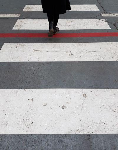 Red Lines RED LINE Walking Around Walkway Traffic Cone Traffic Sign Walking Alone... Woman Walking Forward Straight Ahead Low Section City Pedestrian Women Road Human Leg Walking Street Asphalt Human Foot Crosswalk Crossing Road Intersection Roadways Crossroad Pedestrian Crossing Sign Leg Crossing Sign Zebra Crossing White Line