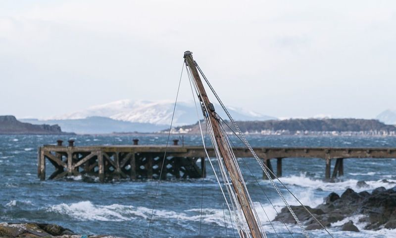 Sailing Boat Mast Mast And Rope Scotland Snow Cold Temperature Outdoors Pastimes Yachting West Coast West Coast Scotland Rugged Coastline Waves White Horses Sea Nature Water Snow ❄ Gillian McBain Photographer Pier Horizon Horizon Over Water Frozen Built Structure