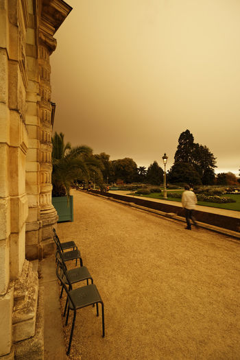 Rennes (Brittany, France), October 16, 2017, the park of Thabor at 15:41. The sand of the Sahara, caught by the hurricane Ophelia, forms a thick yellow-orange filter before the sun. Extraordinary atmosphere! Brittany Chair Cloud Cyclone France Jetstream Rennes Sahara Desert Architecture Built Structure Chairs Cloud - Sky Day Hurricane Hurricane Ophelia Ophelia Orange Color Outdoors Park Public Garden Sahara Sand Sky Tree Yellow