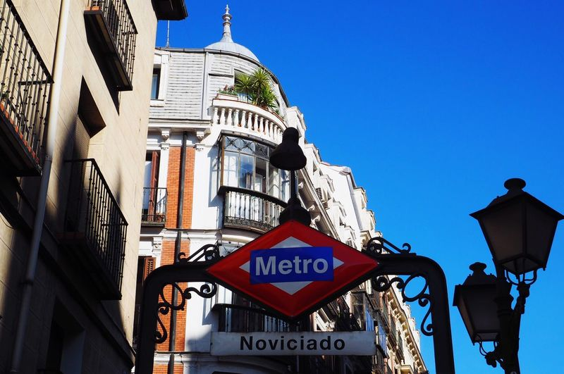 Metro Station Madrid Noviciado Building Sky Travelling Windows Metropolis City Life Railroad Station Metro Station Madrid Spain Sign Text Built Structure Road Sign City No People Information Sign Road Low Angle View Guidance Architecture Information