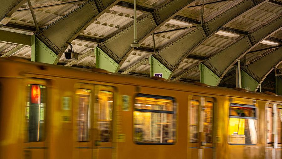 Train at railroad station platform in city