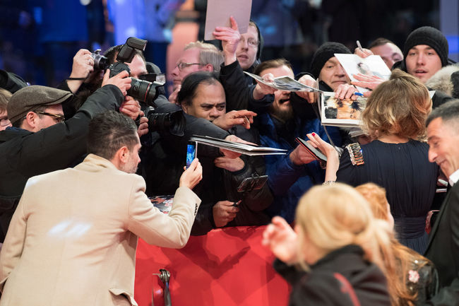 Berlin, Germany - February 18, 2018: Back turned Italian actress Valeria Golino signs autographs for fans while attending the 'Daughter of Mine' (Figlia Mia) premiere during Berlinale Festival 2018 Autographs CAST Film Festival Premiere Valeria Golino Actress Arts Culture And Entertainment Audience Autograph Berlinale Berlinale 2018 Berlinale Festival Berlinale2018 Crowd Fans Film Industry Italian Large Group Of People Outdoors People Real People Red Carpet Red Carpet Event Signing Autographs The Media