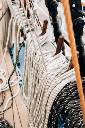 High angle view of ropes hanging in ship