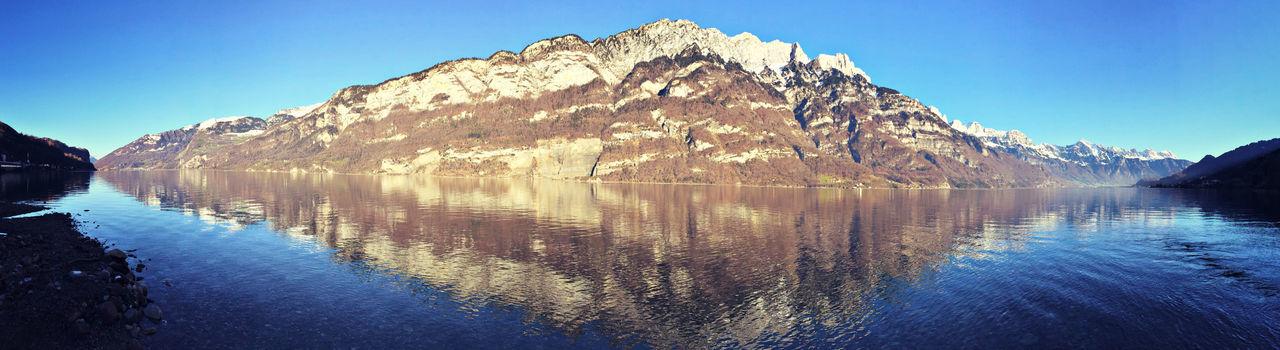 Panoramic view of mountain reflecting in lake