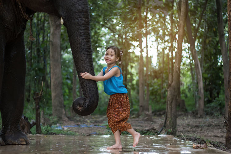 Girl and elephant Fun Happy Rain Thai Thailand Animal Animal Wildlife Elephant Girl Play Wildlife