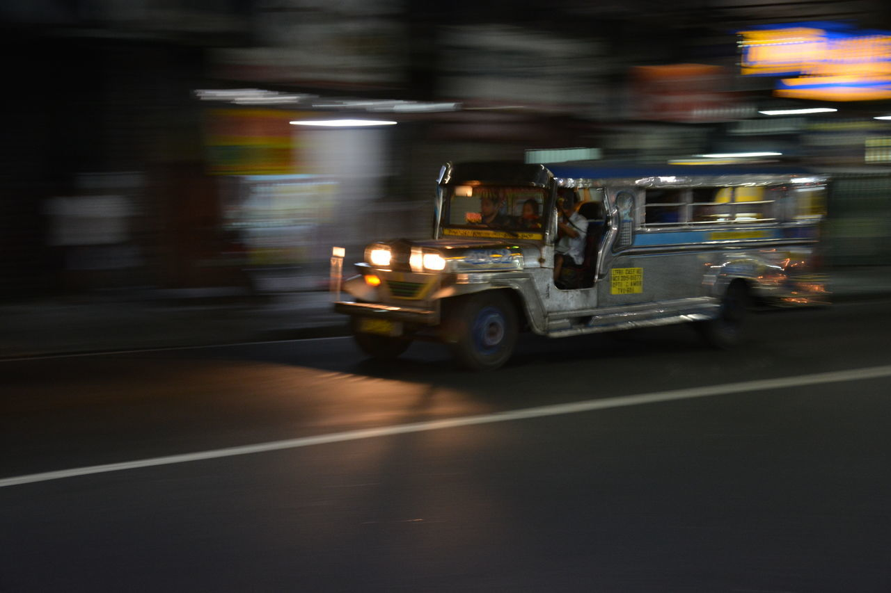 blurred motion, transportation, motion, land vehicle, mode of transportation, street, city, road, speed, architecture, motor vehicle, on the move, car, night, city street, outdoors, illuminated, no people, travel