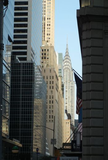 Low angle view of buildings against clear sky in city