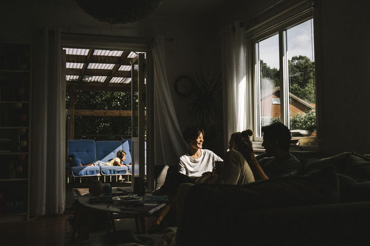 People sitting on table by window
