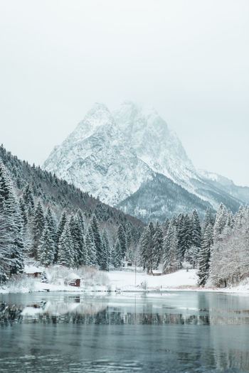 half frozen lake in Bavaria Cold Temperature Winter Mountain Snow Scenics - Nature Beauty In Nature Water Tranquil Scene Tranquility Lake Nature Non-urban Scene Waterfront No People Idyllic Snowcapped Mountain Outdoors Mountain Peak Snow Covered Snowing Frozen Frozen Lake Reflection Forest Mountain Range