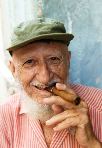 Portrait of senior man with cigar