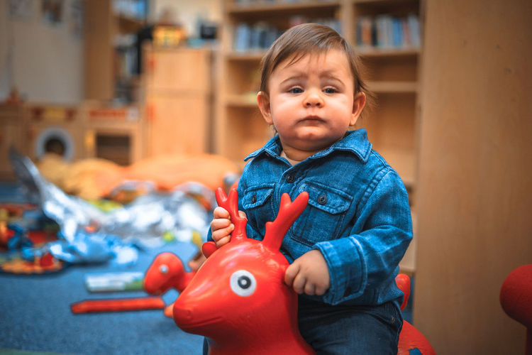 Babyboy Deer Play Time Babies Only Babyhood Blue Childhood Cute Day Denim Indoors  Lifestyles Looking At Camera One Person Playground Portrait Red Color Riding Standing