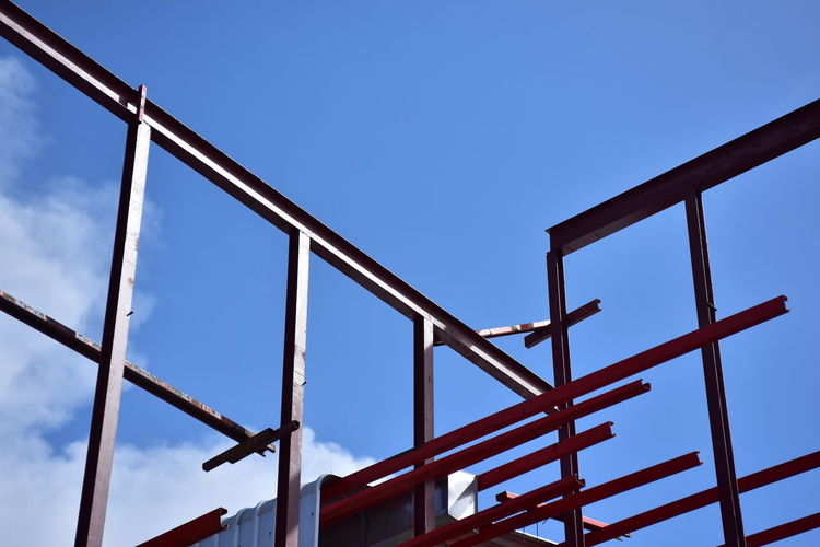 Low angle view of bridge against blue sky