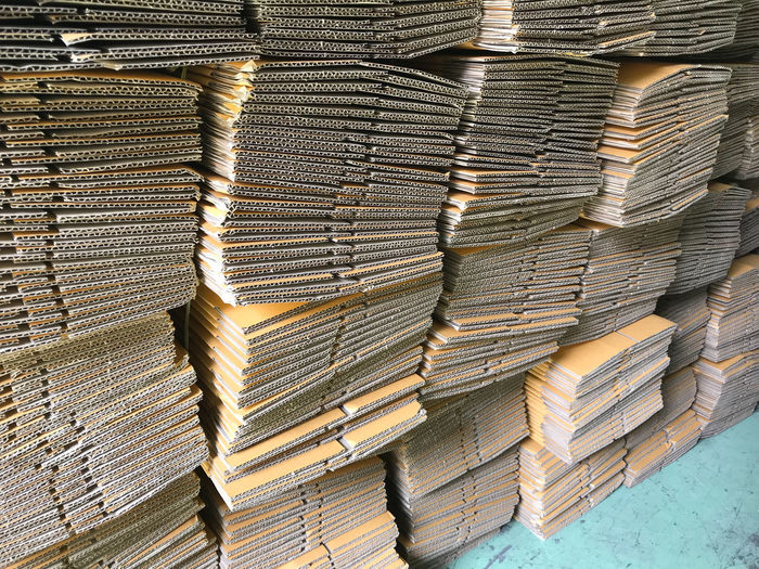 Cardboard sheets stacked in warehouse