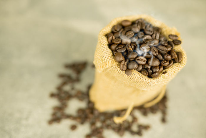 coffee bean and sackcloth Coffee Bean Close-up Day Food Food And Drink Freshness Healthy Eating Indoors  No People Sackcloth Seed Selective Focus Still Life Table