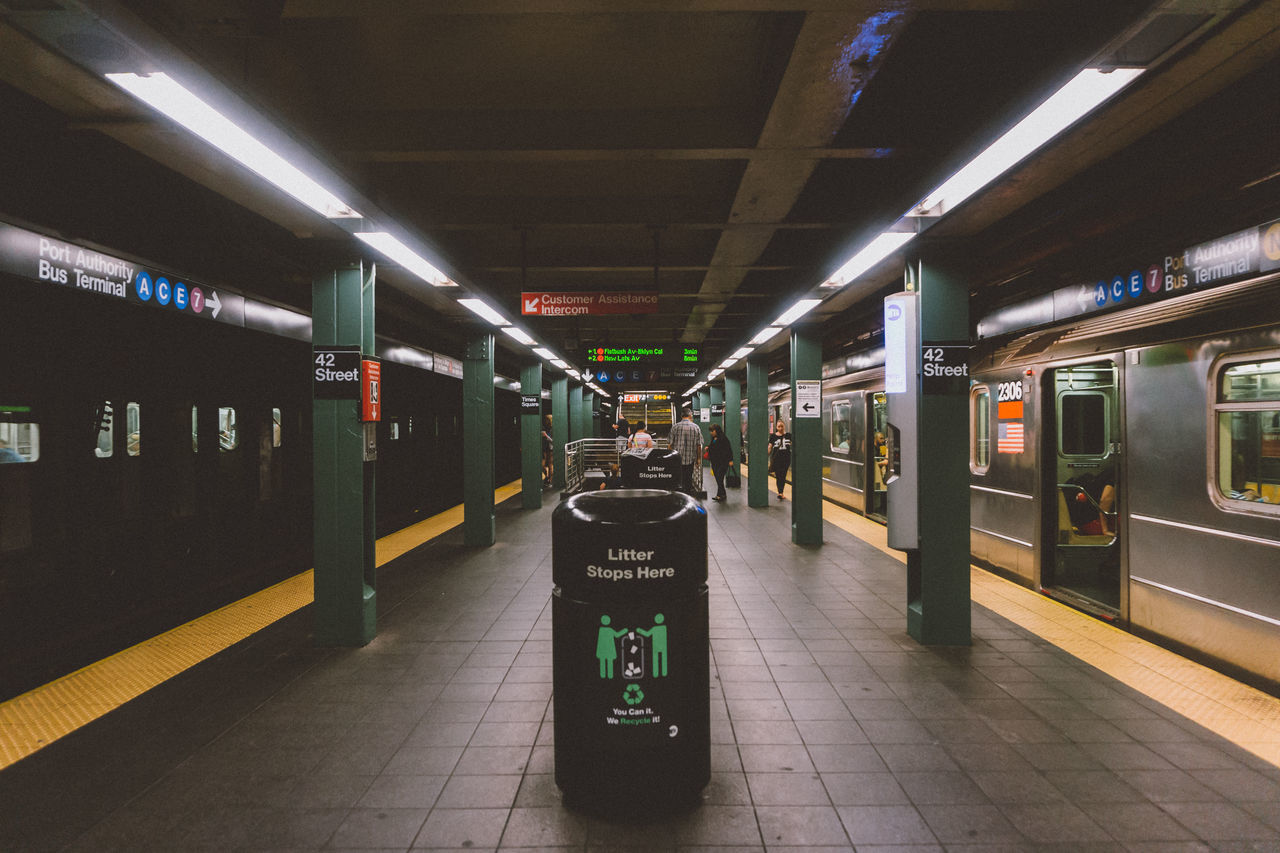 Garbage Can At Illuminated Subway Station
