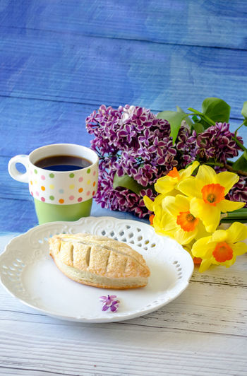 Close-Up Of Breakfast With Flowers On Table
