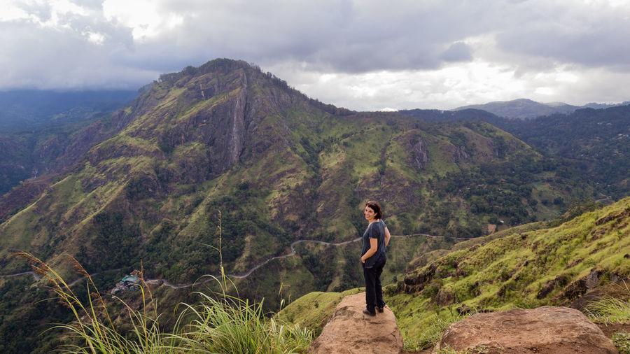 Woman on landscape against mountains