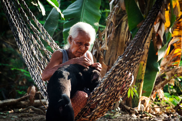 Senior Woman Sitting In Hammock
