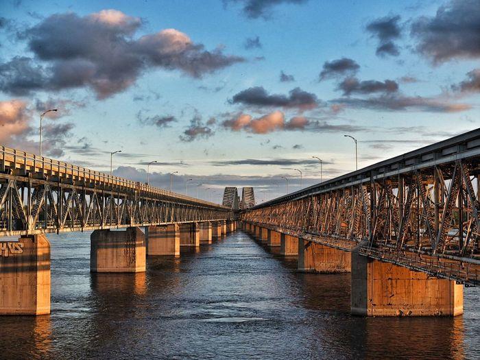 Honore mercier bridge over saint lawrence river against sky