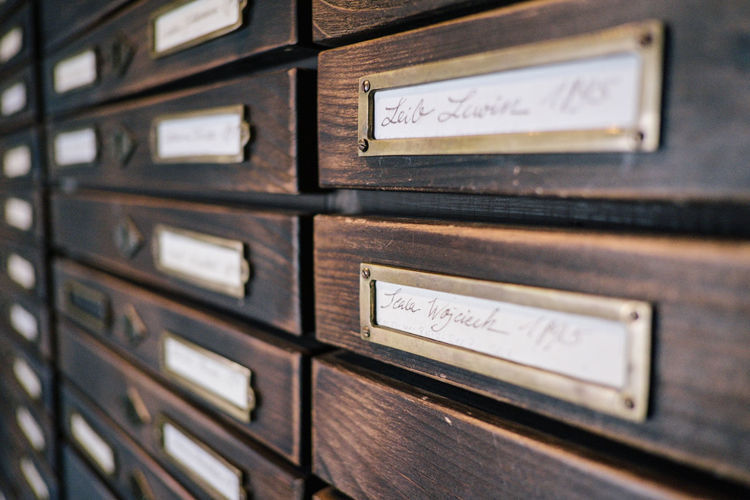 Indoors  No People Close-up Wood - Material In A Row Communication Selective Focus Text Drawer Old Metal Full Frame Mailbox Repetition Western Script Business Furniture Day Correspondence File Cabinet Cabinet