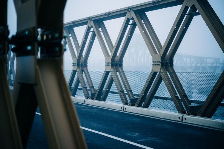 Closeup of an iron bridge at deep fog