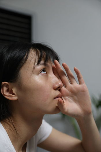 Close-up of thoughtful woman at home