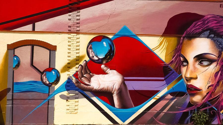 The wonderwall Lisbon Lisboa Portugal Portrait Of A Woman Travel Travelphotography Olympuskameras Omdem10mkii Getolympus EyeEmNewHere Colorful Multi Colored Close-up Street Art Art Graffiti ArtWork Representation Female Likeness Spray Paint Mural Painted Image