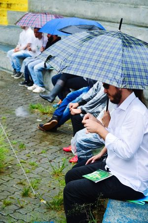 Umbrella Rain Men Women Sitting Urban Scene Social Responsibility Environmentalist RainDrop Rainfall Monsoon Rainy Season Sustainable Lifestyle Sapling Vanguardians