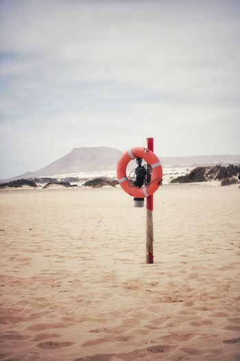 Red lifesaver on the beach